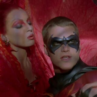 Poison Ivy tries to seduce Robin.