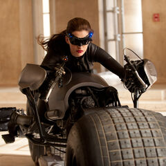 Catwoman on the bat pod.