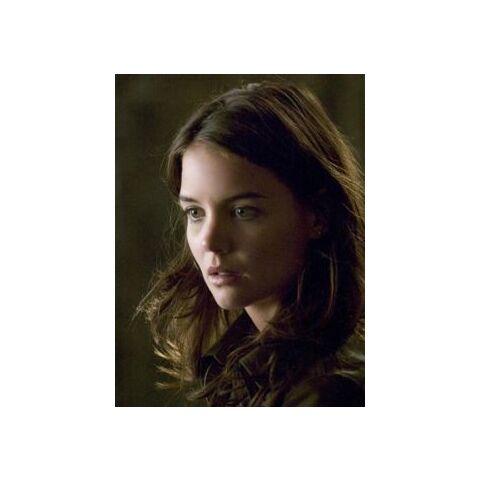 Katie Holmes as Rachel Dawes.