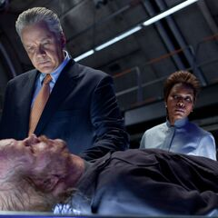 Senator Hammond and Amanda Waller examine Hector.