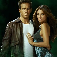 Ryan Reynolds and Blake Lively as Hal Jordan and Carol Ferris
