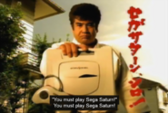 Segata Sanshiro - Segata Sanshiro hands out his Sega Saturn to you as he expects you to play it