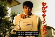 Segata Sanshiro - Segata Sanshiro hands out his Sega Saturn to you as he expects you to play it