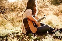 Katy Playing guitar
