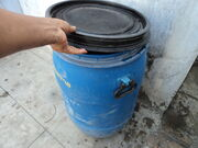 Lid-closing gesture-plastic drum-Tamil Nadu