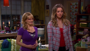 Penny and Bernadette look at the painting