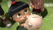 Agnes giving her-piggy-bank
