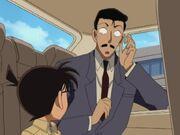 Kogoro noticing Conan in the car