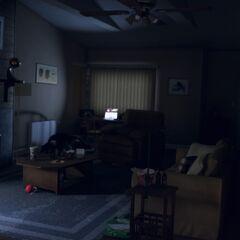 Das Wohnzimmer, mit Sumo in der dunklen Ecke