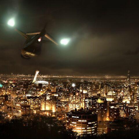 СВВП Малик пролетает над Монреалем. Вдалеке виден олимпийский стадион