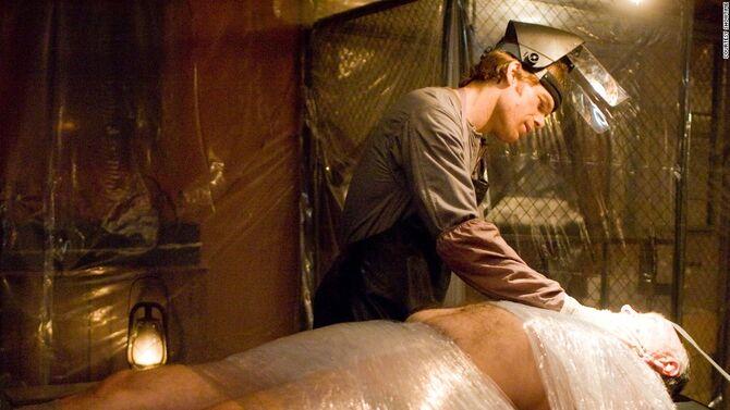 Dexter dismembers Santos Jimenez in the cabin