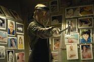 Dexter kills Trinity with hammer