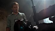 Dexter over Travis' dead body