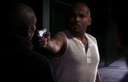 2 Julio pulls a gun