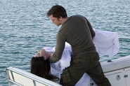 Dexter buries Debra at sea