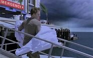 Dexter carries Debra's body to his boat