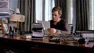 Dexter at his desk