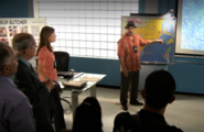 Batista pointing to Coral Cove Marina S2E5
