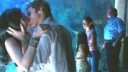 Dexter and Lila kiss at theaquarium