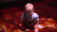 Harrison sits in blood