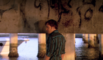 Dexter under bridge at Bayard crime scene