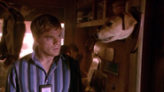 Dexter inside Neil Perry's mobile home