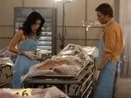 Dexter shows Lila the field morgue