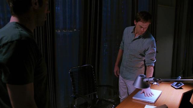 File:Dexter at his desk.png