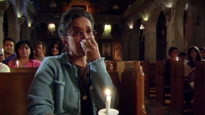 Mrs. Tucci weeping in church