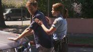 Zoey Kruger frisks Dexter