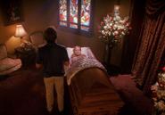 Rita in casket