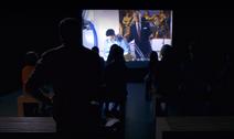 Dexter watches film in museum