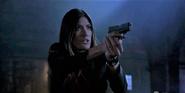 Debra pulls gun on Dexter after she witnesses him kill Travis Marshall