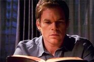 Dexter studies Brother Sam's Bible