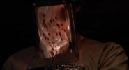 Dexter's visor, spattered with Santos Jimenez' blood