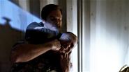 Dexter chokes Estrada