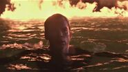Dexter swims away from Lake of Fire tableau
