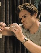 Dexter looks at Walter's broken blood slide
