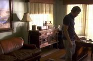 Dexter looks for Ellen's ring in Miguel's study