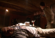 Dexter and Garza inside the cabin