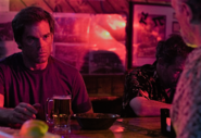 Dexter stares at Santos Jimenez in his Naples' bar