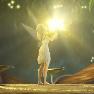 Tinker Bell grabs the hammer... and it glows