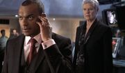 DHS- Charles Robinson (Colin Salmon) and M (Dame Judi Dench) in 007 Die Another Day (2002)