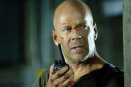 John McClane in LFODH on walky talky