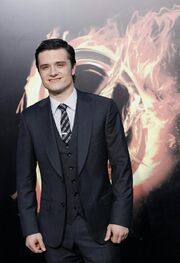 247880-cast-member-josh-hutcherson-poses-at-the-premiere-of-the-hunger-games-