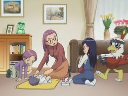 Yolei changing her baby's diapers