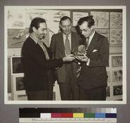 Walt Disney Edwin Powell Hubble and Julian Huxley looking at a dinosaur model