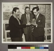 Walt Disney Edwin Powell Hubble and Julian Huxley looking at a dinosaur model
