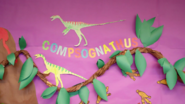 Compsognathus made from paper by kids