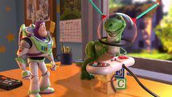 Buzz watching Rex play